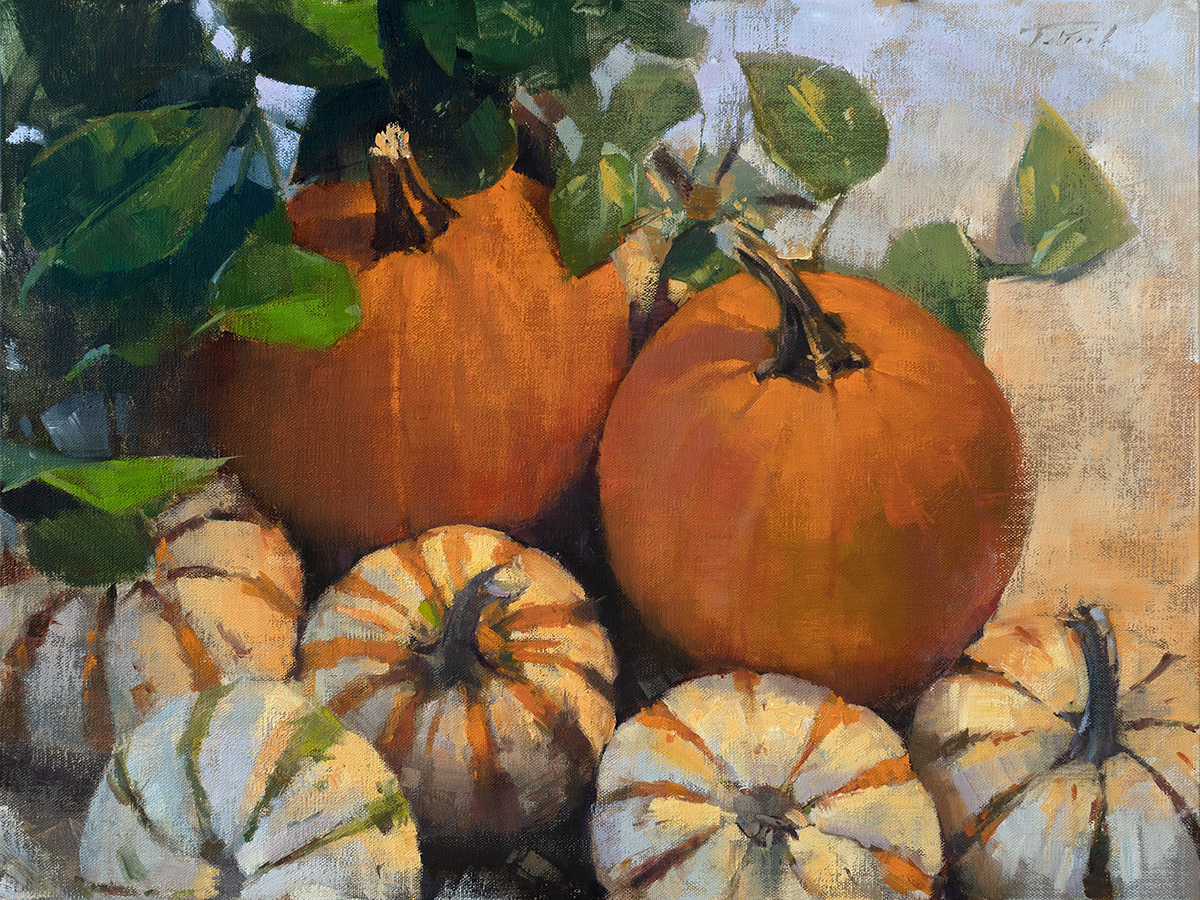 Grouping of pumpkins, orange, green and white, orange and white with green leaves under Fall sun.
