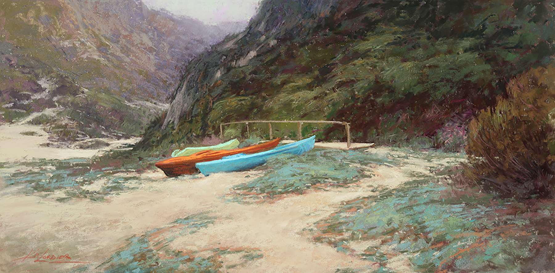 Two colorful canoes waiting in the sand on the coast.