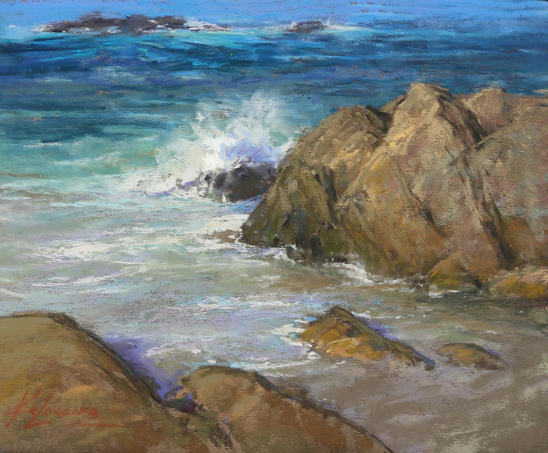 Carmel coastline, ocean splashing against rocks.