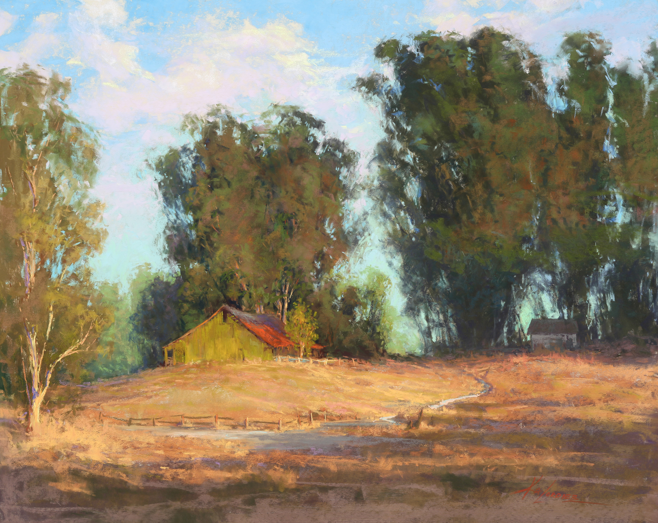 Western scene with barn and trees.