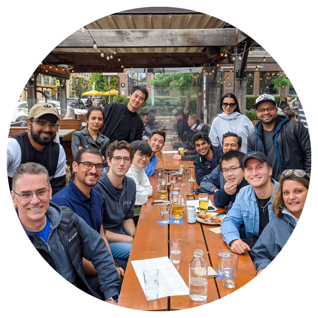 Image of the ODAIA team hanging out at a patio in Toronto
