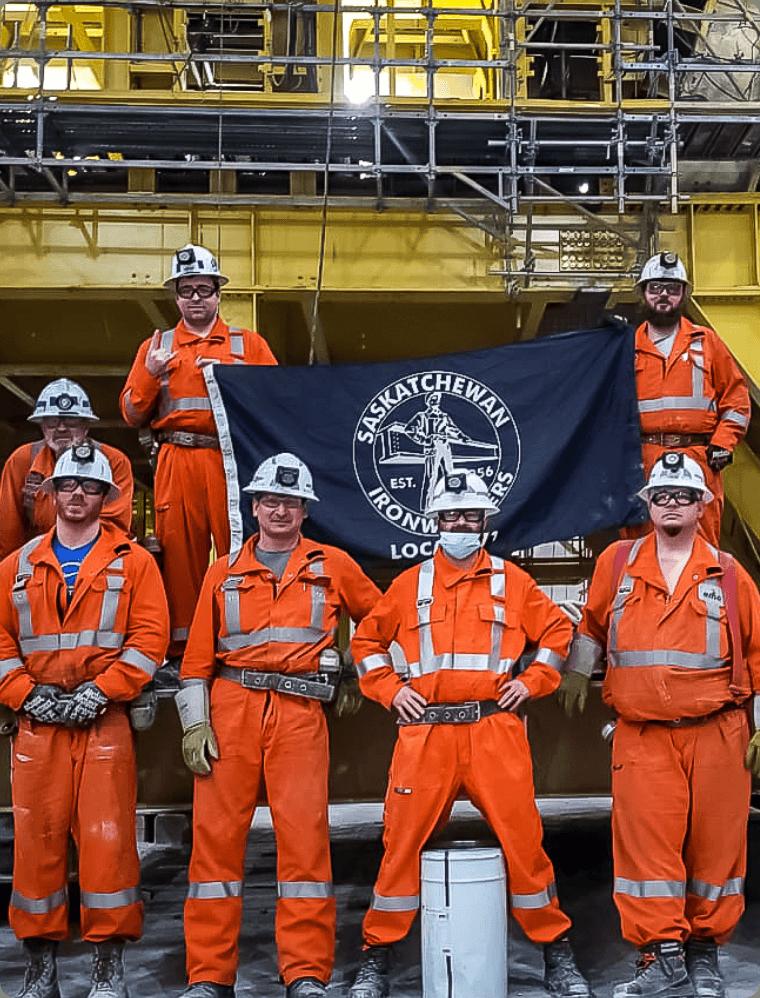 Saskatchewan Ironworkers team wearing orange uniform and helmets