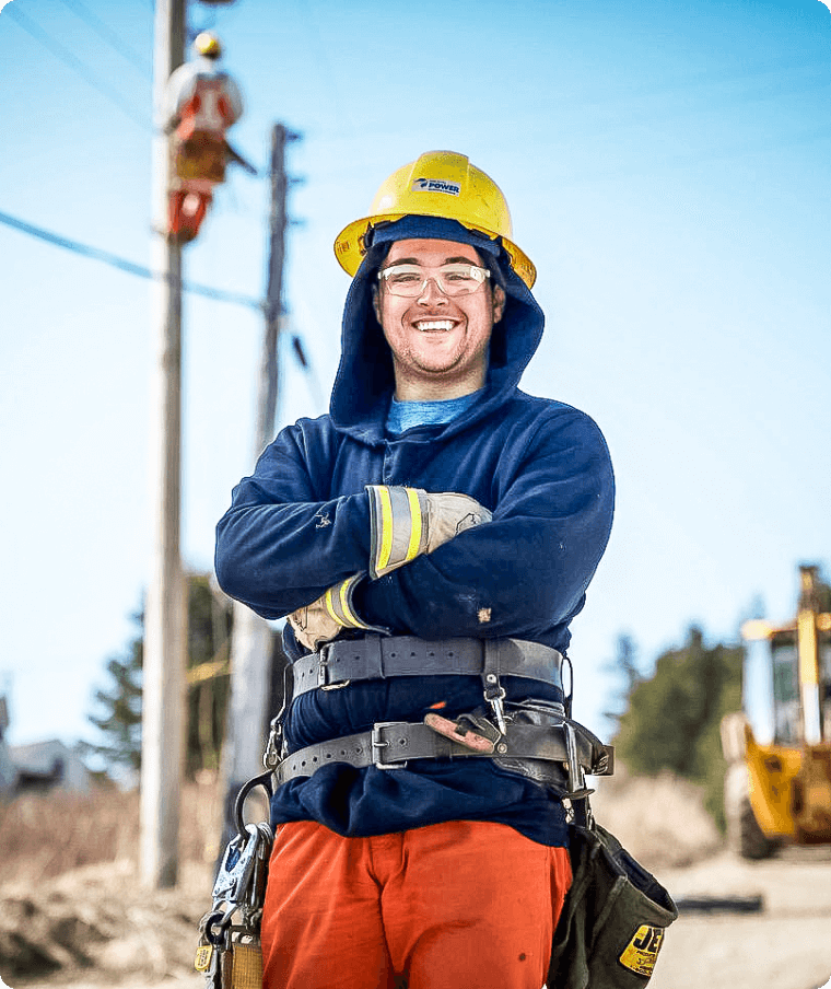 Two electricity workers on a power pole