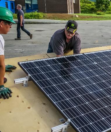 A man installs solar cells