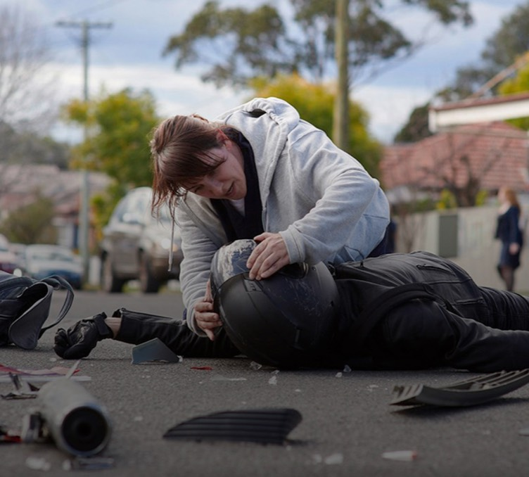 A still from our Aware Super campaign depicting a nurse assisting the victim of a motorcycle accident.