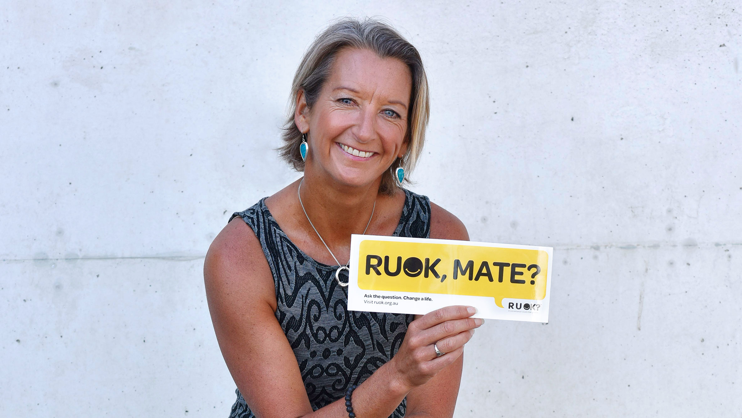 R U OK? Hero with Layne Beachley holding up a speech bubble with R U OK?