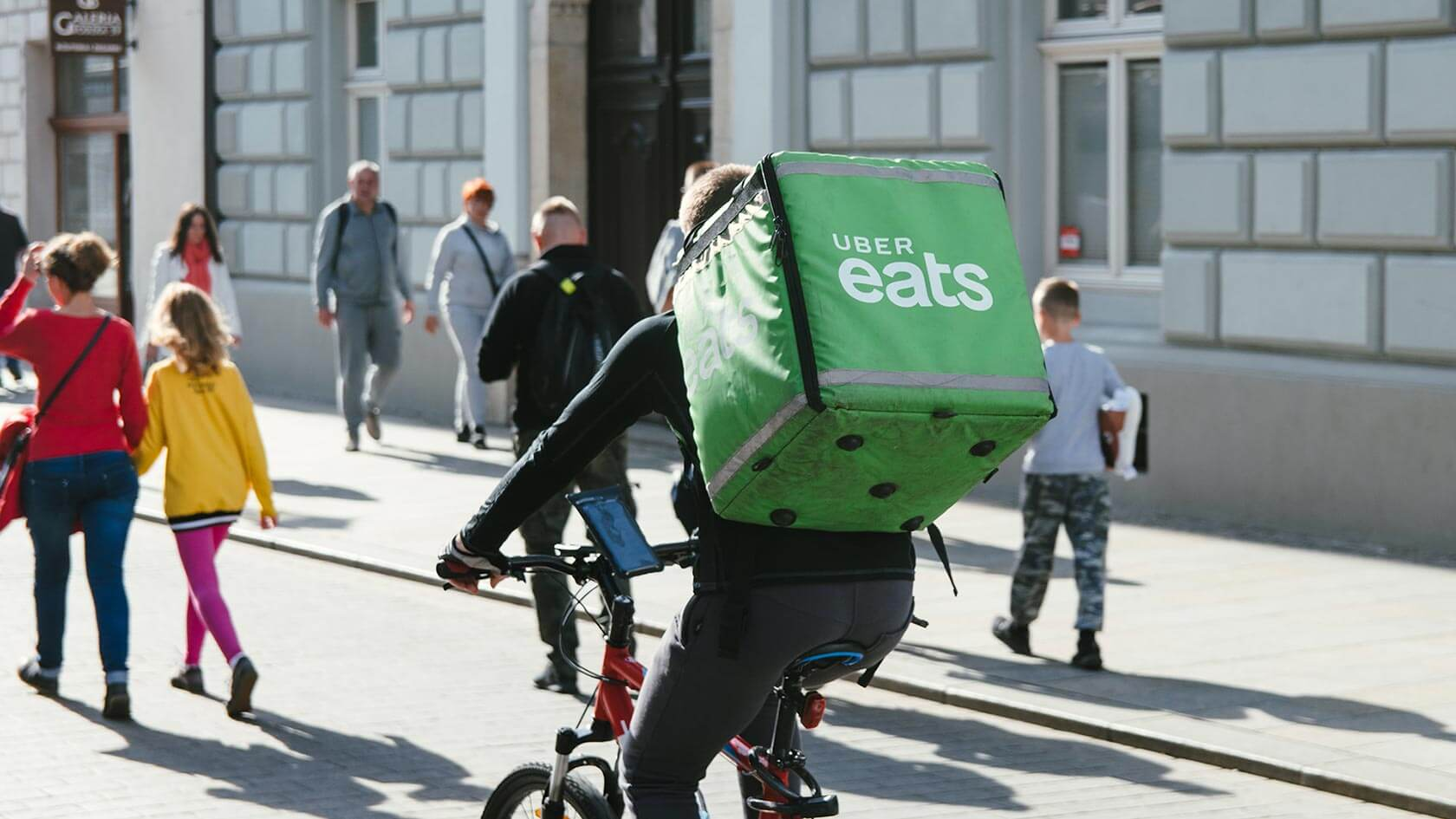 An Uber Eats delivery rider riding his bicycle