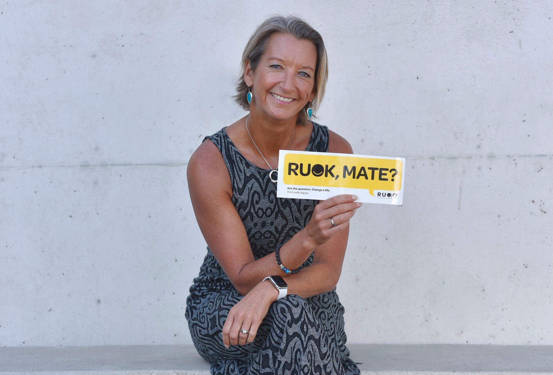 Layne Beachley holding an RUOK sticker