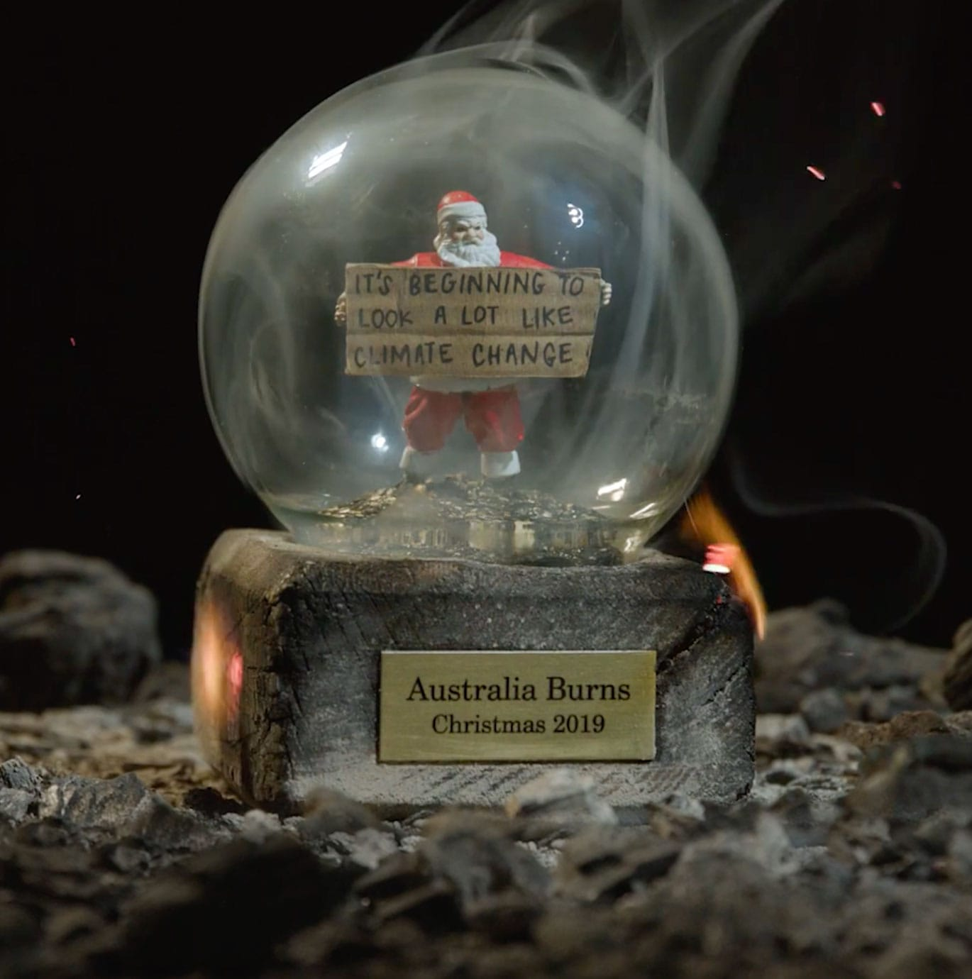 Greanpeace hero image of snow globe filled with ash