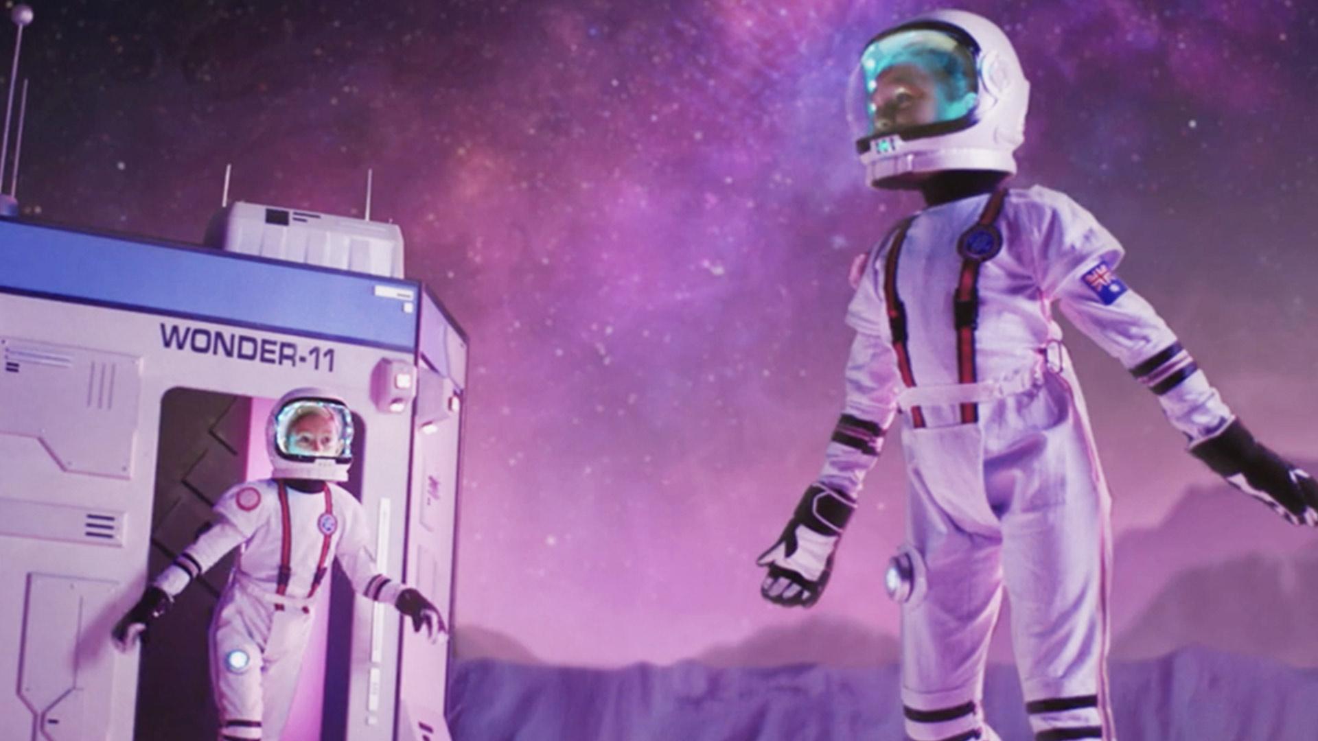 Wonder hero two children is space wearing space suits