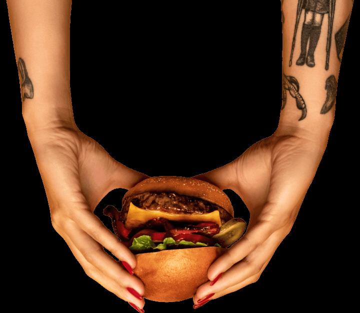 hands holding burger inverted