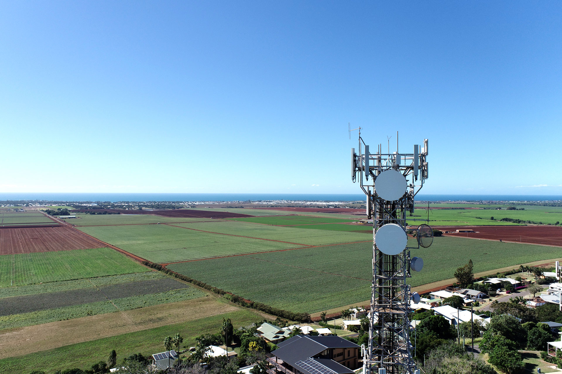 An Amplitel tower looking over country side out to the coast