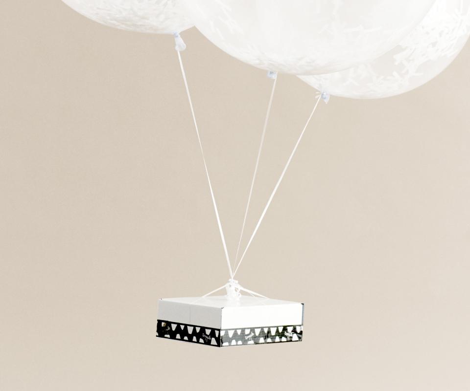 A Dopple Drop box arriving via large balloons.