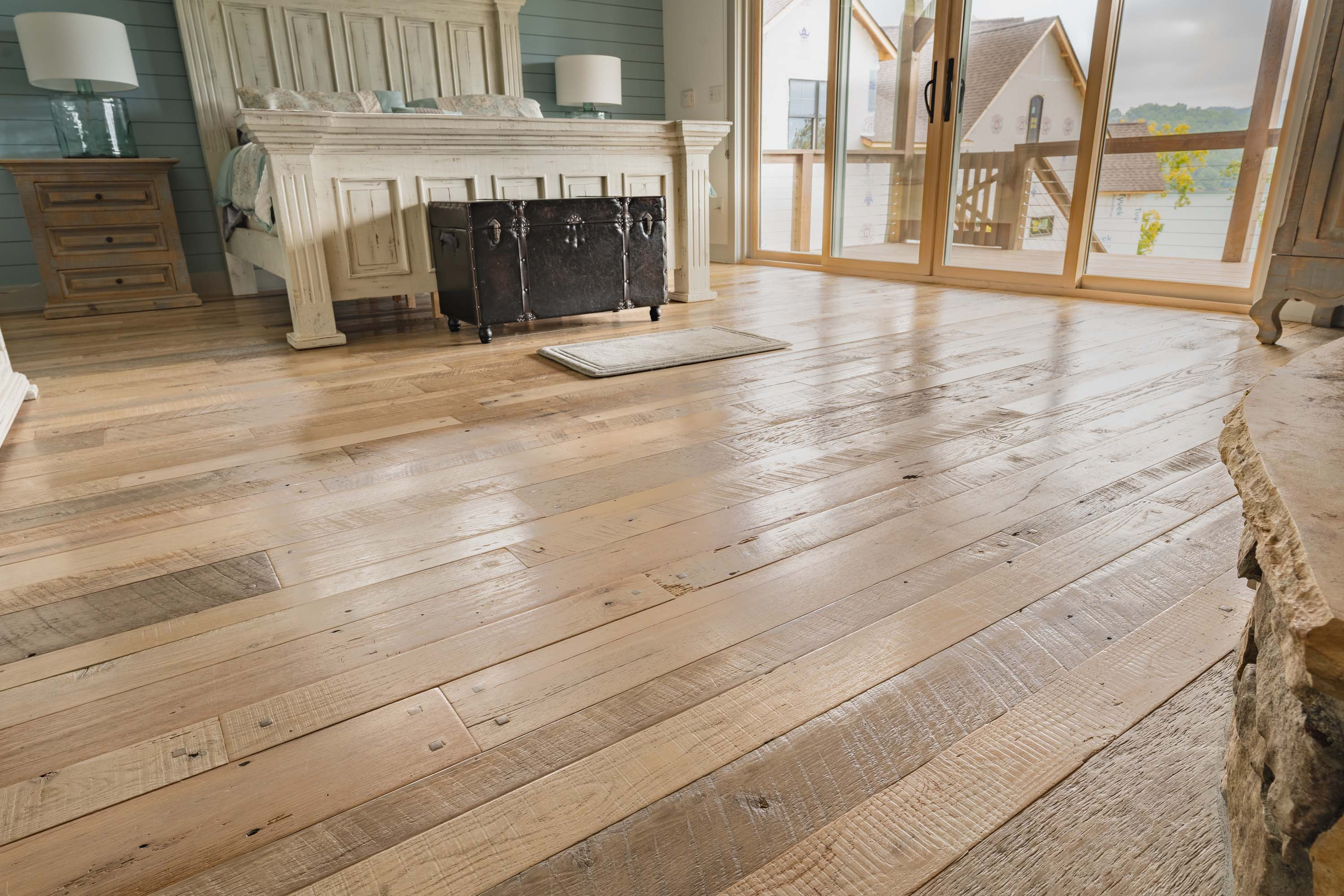 A bedroom with Nantucket Reclaimed Wood Flooring by Tennessee Wood Flooring. These floors are real hardwood floors made locally.