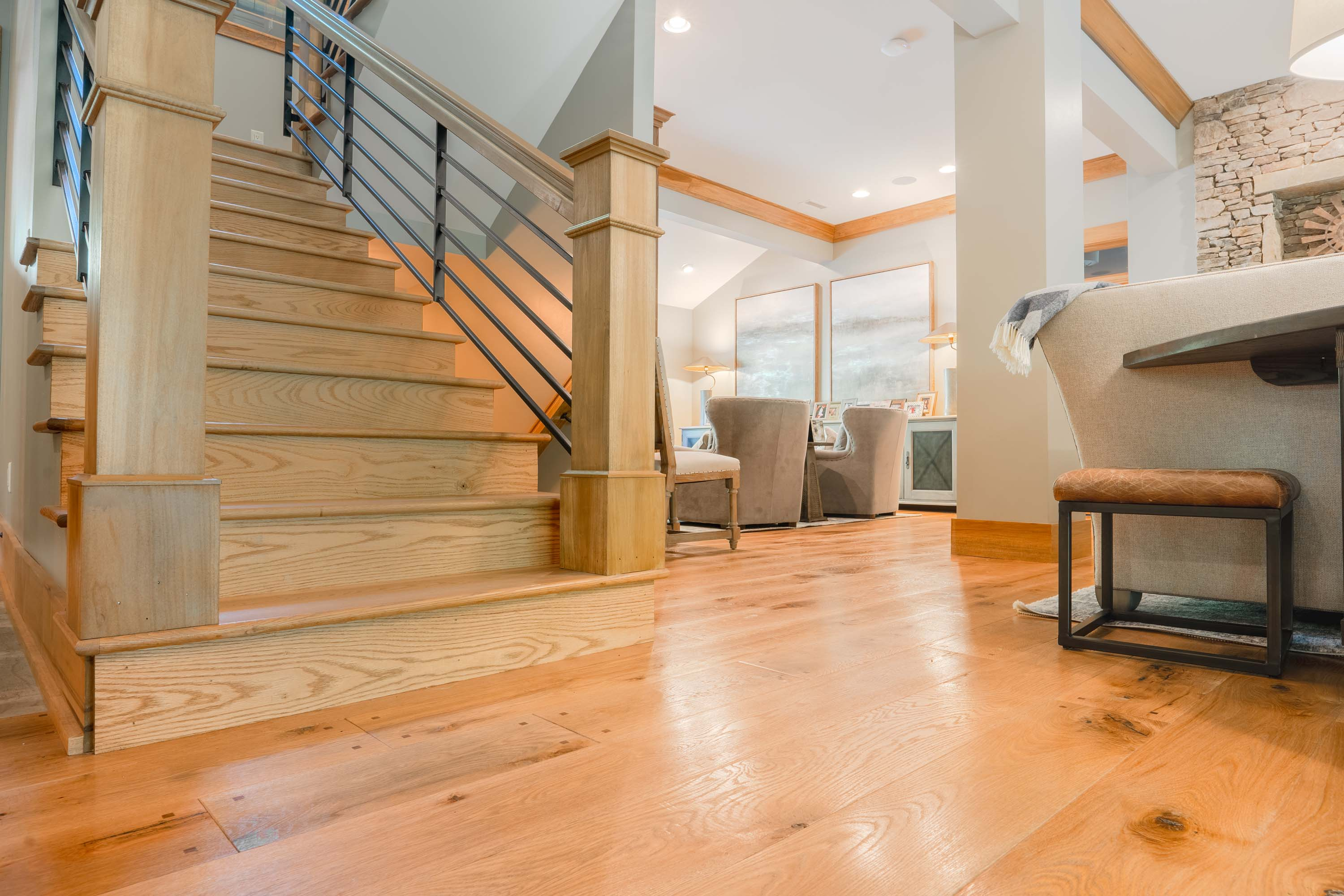 a staircase with Montana Plank Reclaimed Wood Flooring by Tennessee Wood Flooring. Our Reclaimed Wood Floors are gathered and made in the hills of sevierville, tennessee.