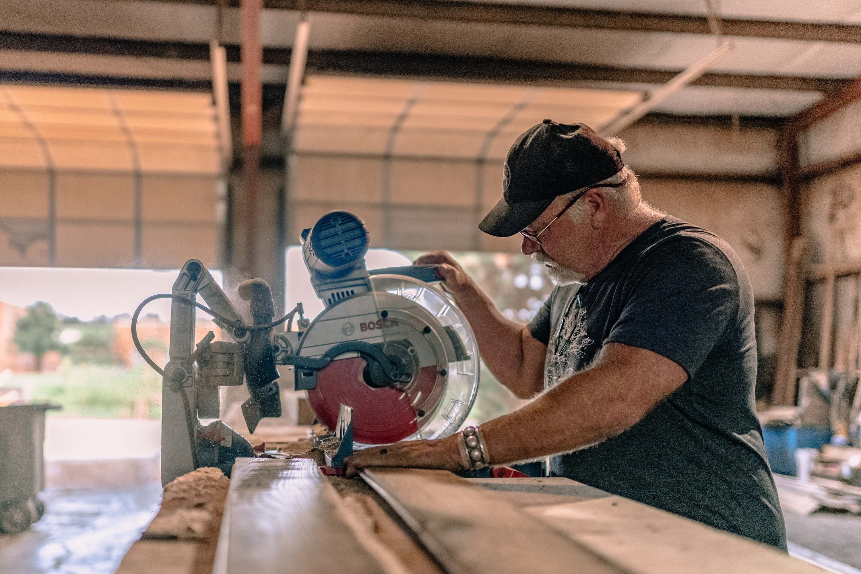 A photo of people working in our factory making authentic, real hardwood and wood flooring in East Tennessee.