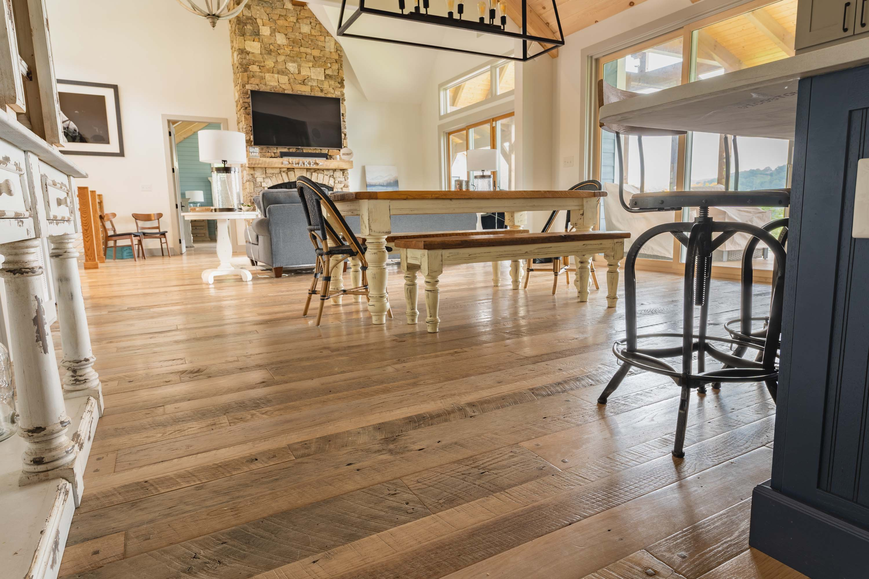 A living room in a house with Nantucket Reclaimed Wood Flooring by Tennessee Wood Flooring. These floors are real hardwood floors made locally.