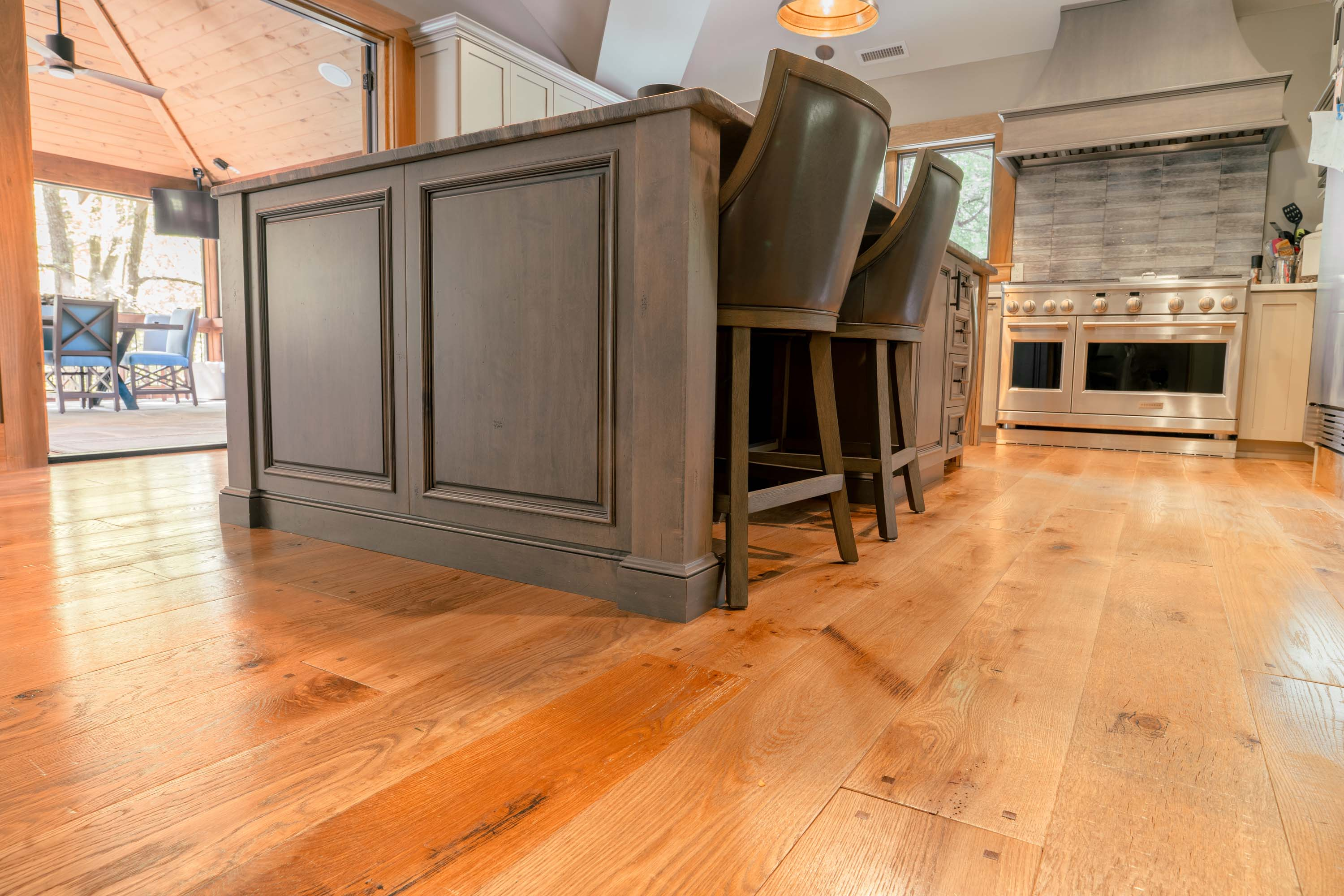 a kitchen with Montana Plank Reclaimed Wood Flooring by Tennessee Wood Flooring. Our Reclaimed Wood Floors are gathered and made in the hills of sevierville, tennessee.