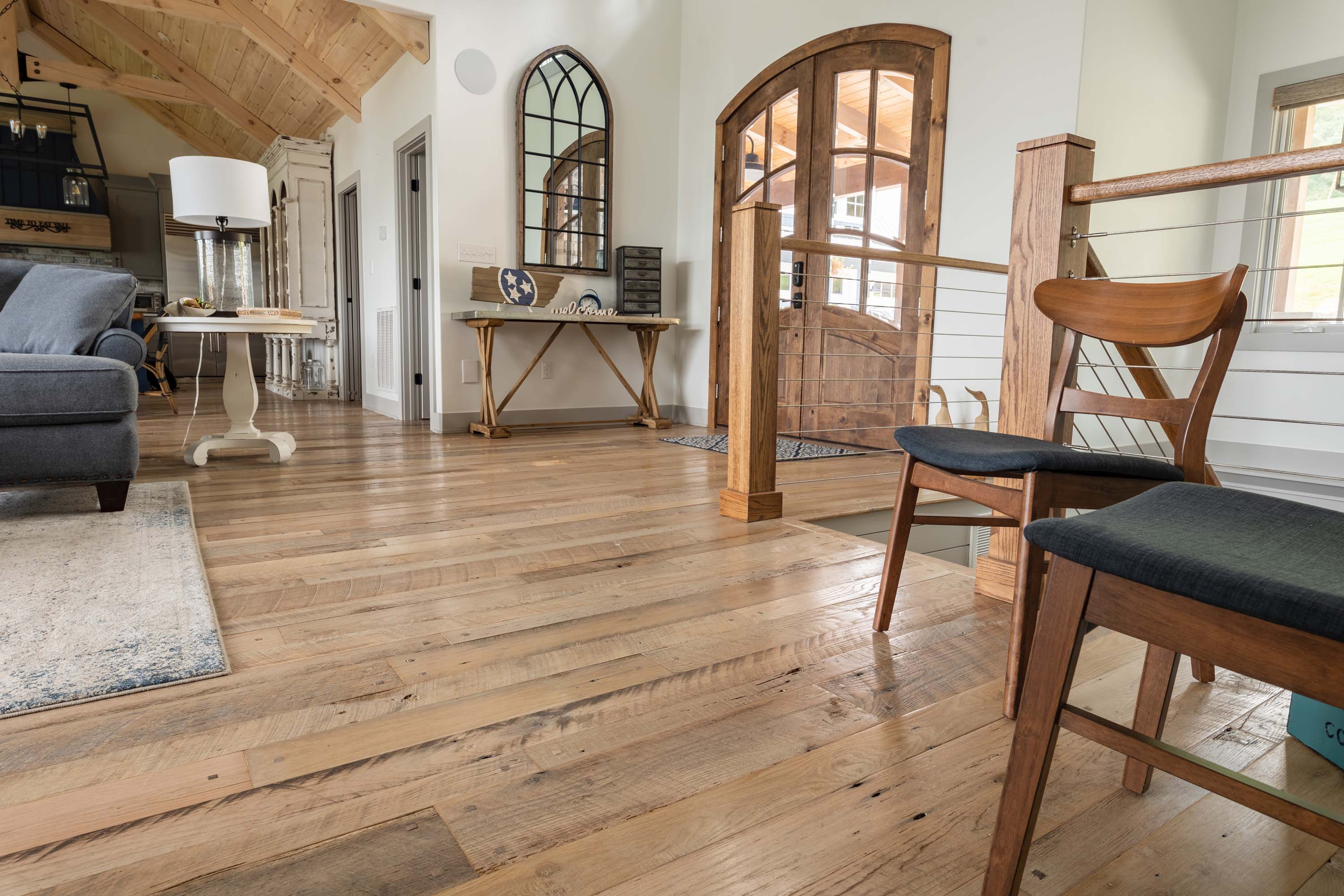 A living room area in a house  with Nantucket Reclaimed Wood Flooring by Tennessee Wood Flooring. These floors are real hardwood floors made locally.