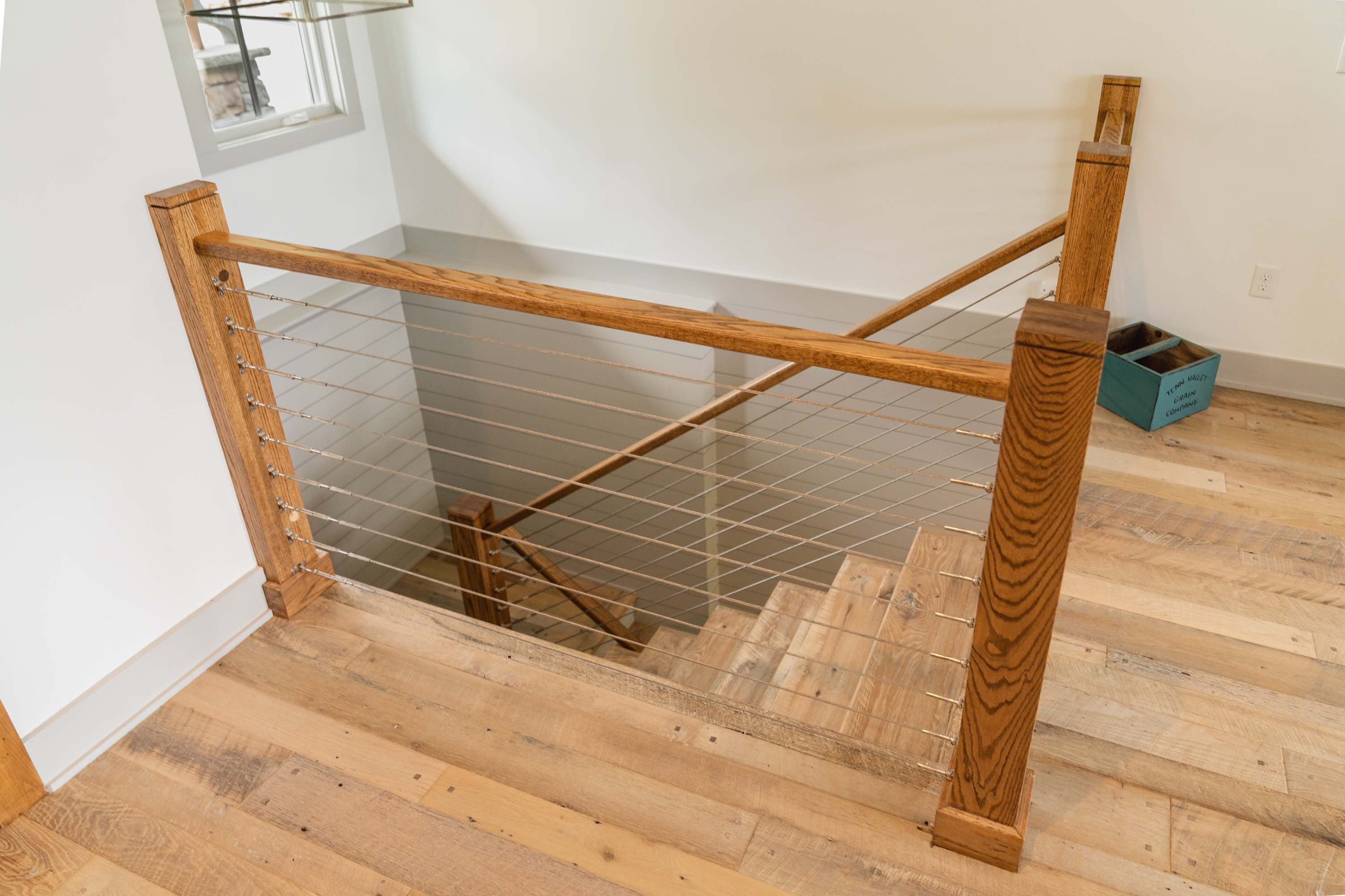 A staircase with Nantucket Reclaimed Wood Flooring by Tennessee Wood Flooring. These floors are real hardwood floors made locally.