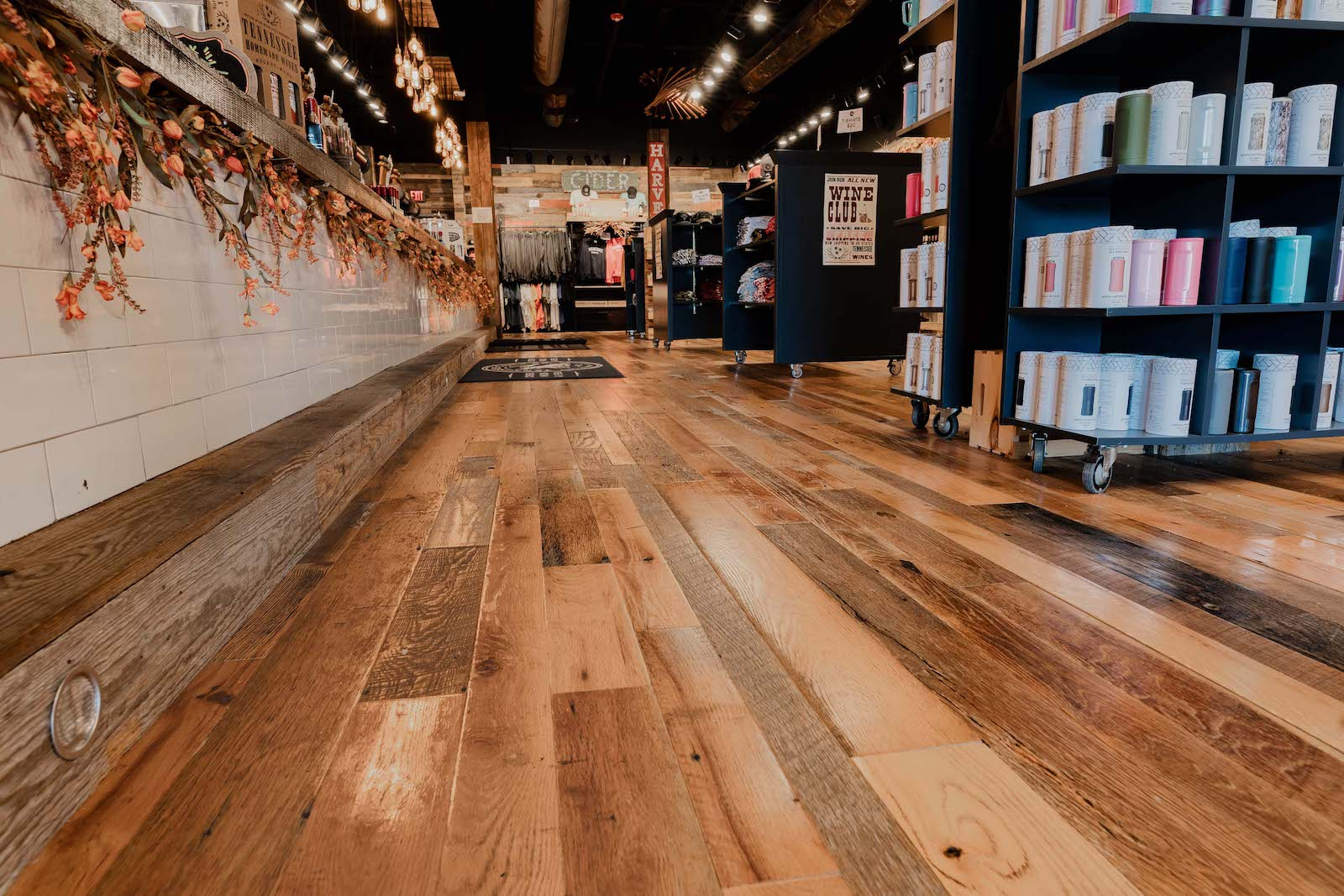 Tennessee Wood Flooring's hardwood Floor inside of Tennessee Cider Companies Locations in Gatlinburg and Sevierville. The Floor in here is a reclaimed Barnside and Beam Oak Wood Floor