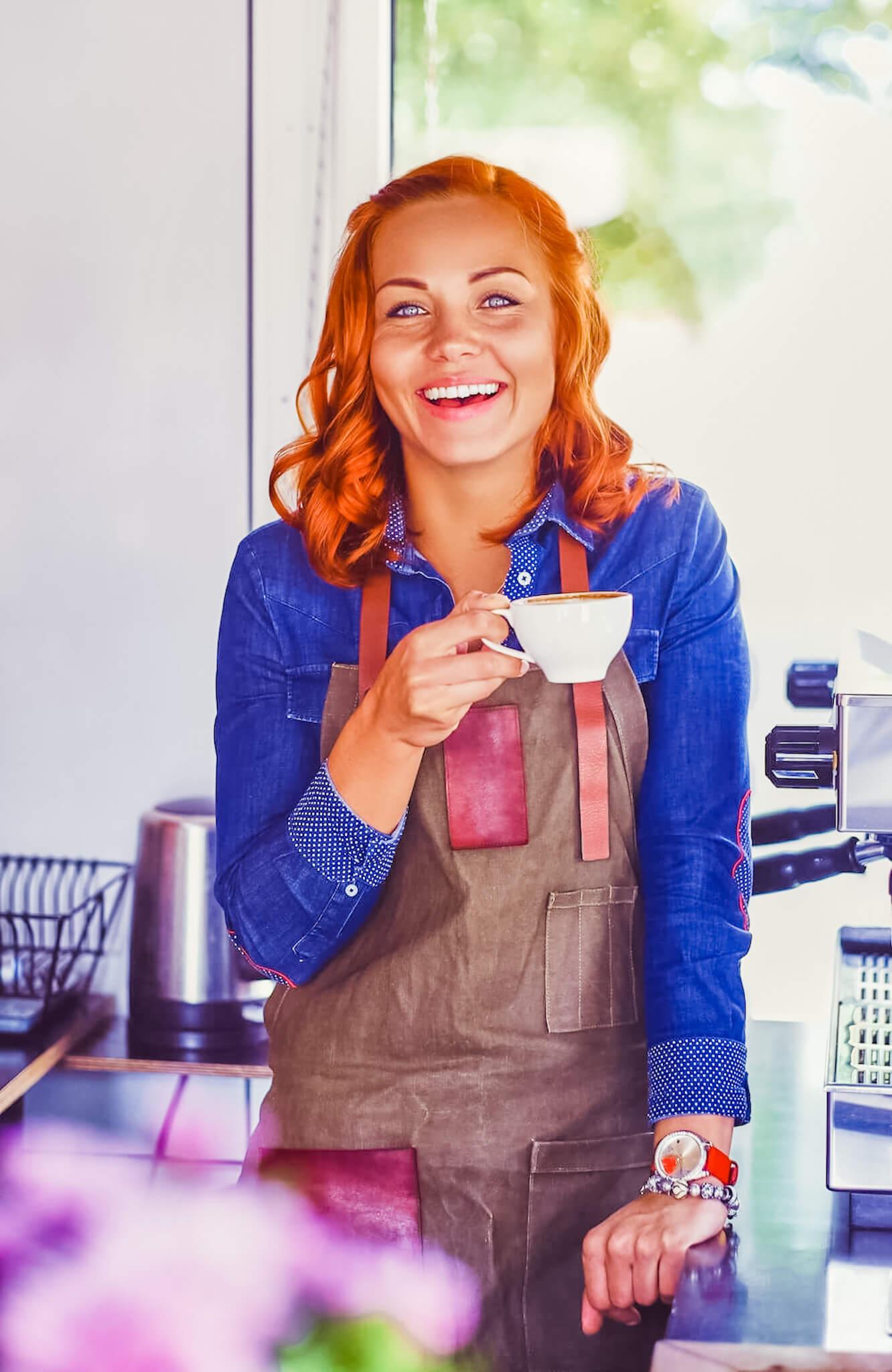 Cafe Owener smiling.