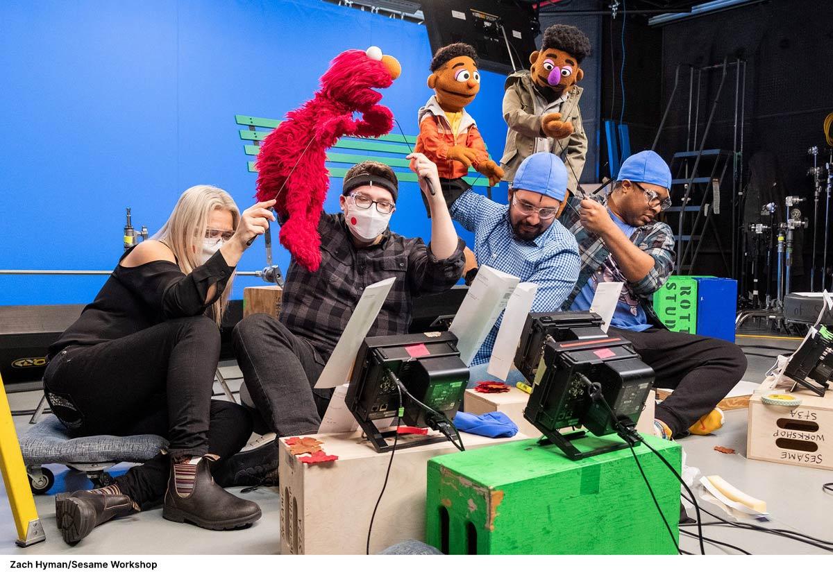 Sesame Puppeteers on set