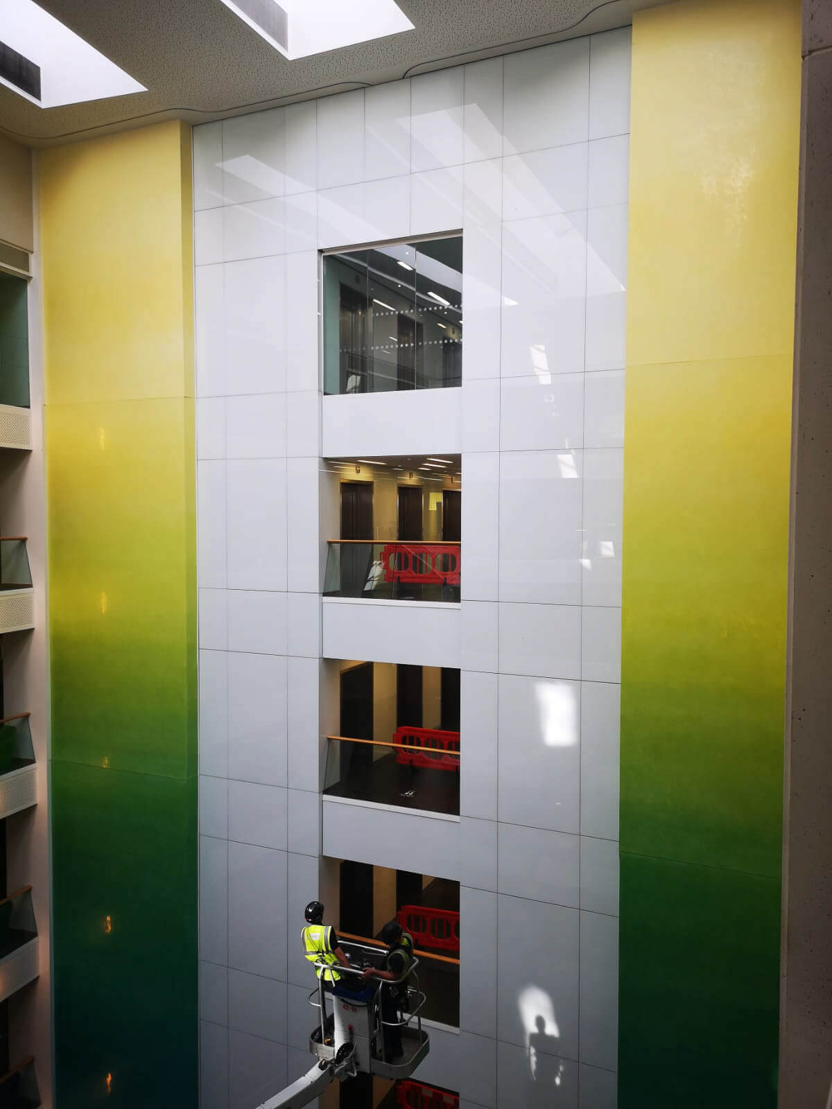 GR were tasked to remove and refurbish this extensive high level internal glass feature wall.