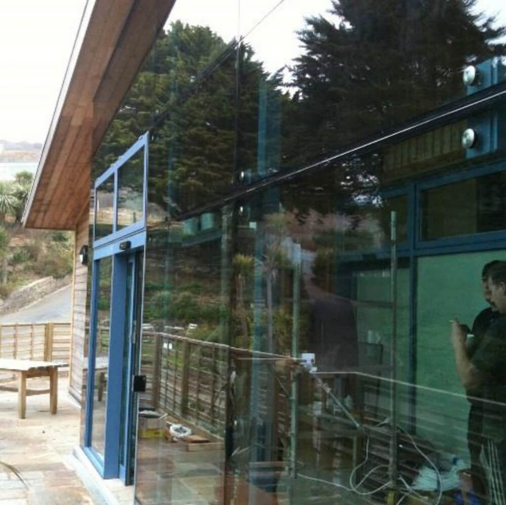 Infill an existing open terrace area with a point fixed glazed screen