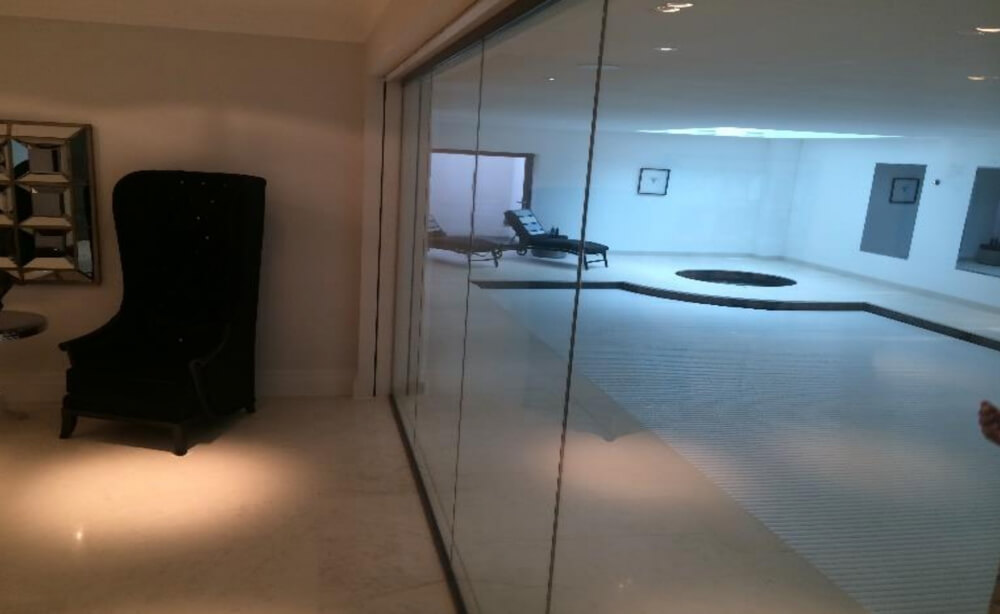 Designed, manufactured and installed fixed glass internal partitions between a swimming pool and lounge