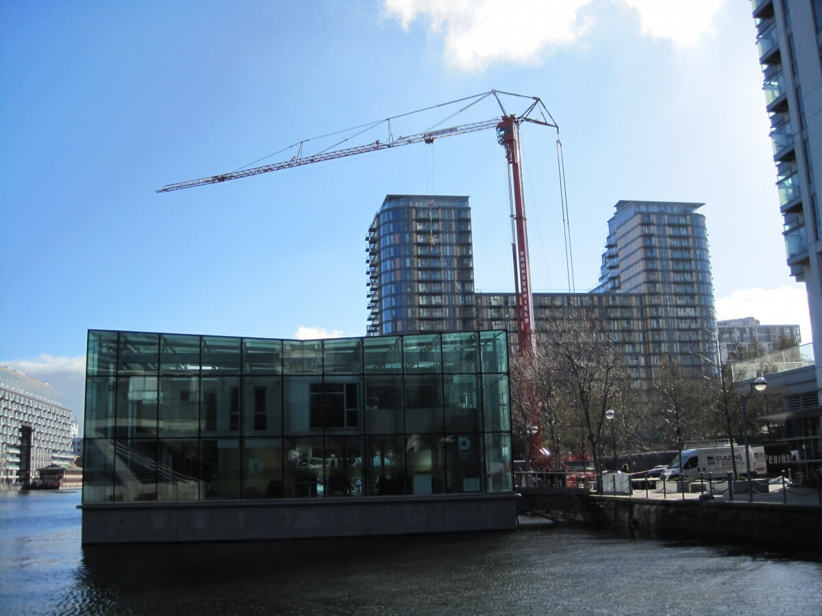 Replacement glazing for a floating cube office on the River Thames