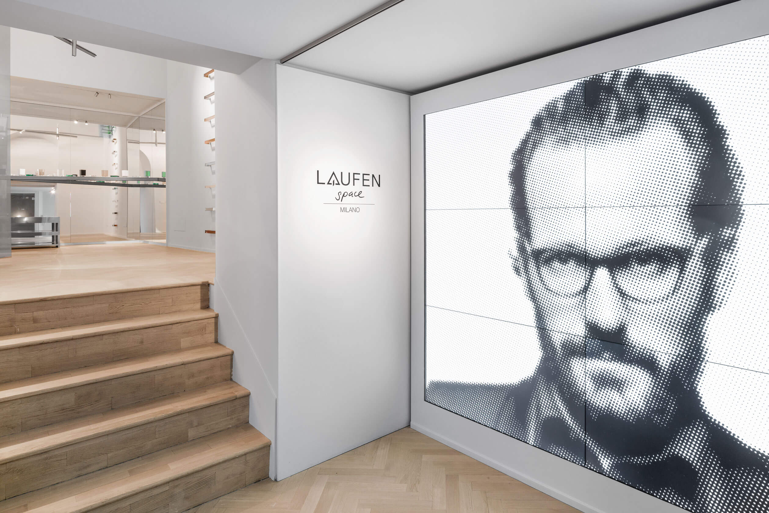 Huge screen with a portrait image in Laufen space Milano entrance area.