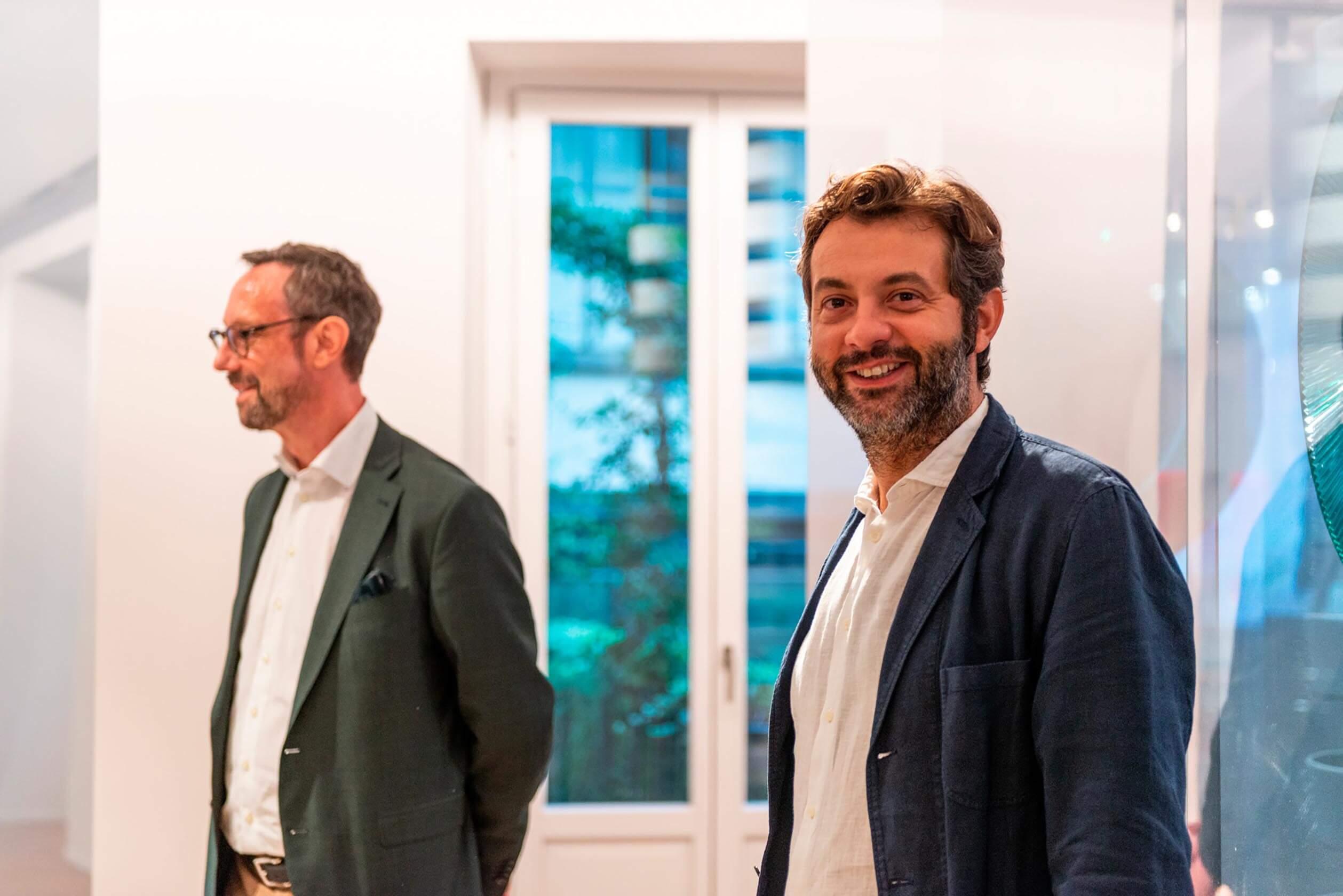 Roger Furrer and Matteo Fiorini standing in the Laufen space Milano exhibition.