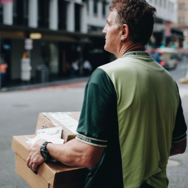Parcel delivery driver holding package