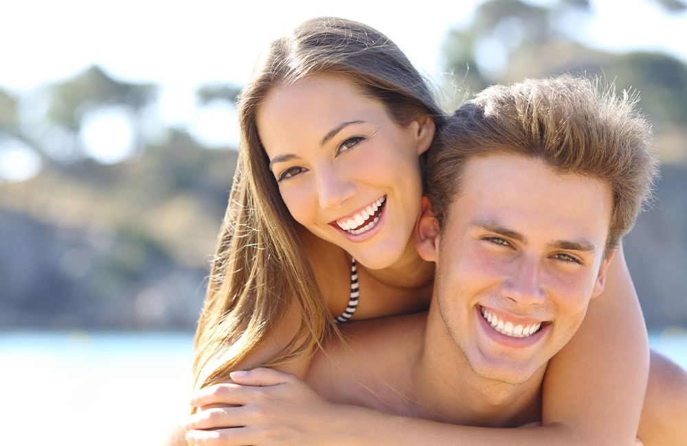 A young couple with remarkably pristine teeth,