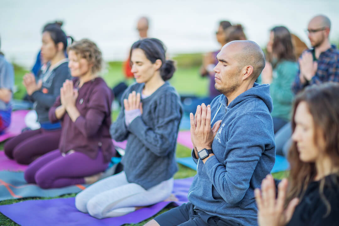 Yoga workshop participants in seated meditation.