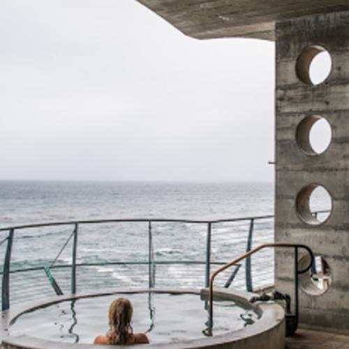 The Esalen Baths overlook the Pacific Ocean.