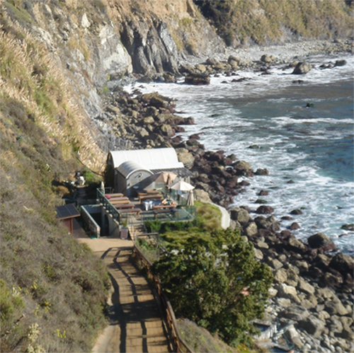 A path leads from the back deck of the Esalen Lodge down to the baths.