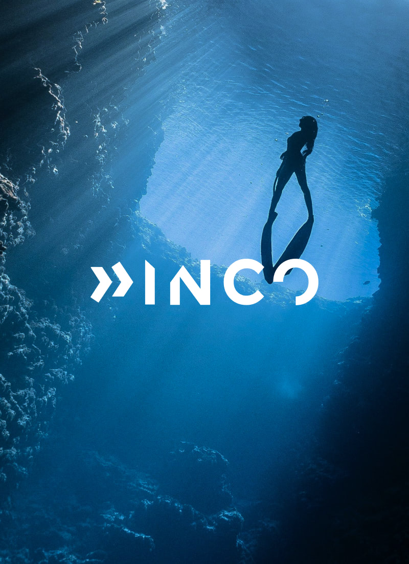 Scuba diver photo from underwater with Inco company logo over top