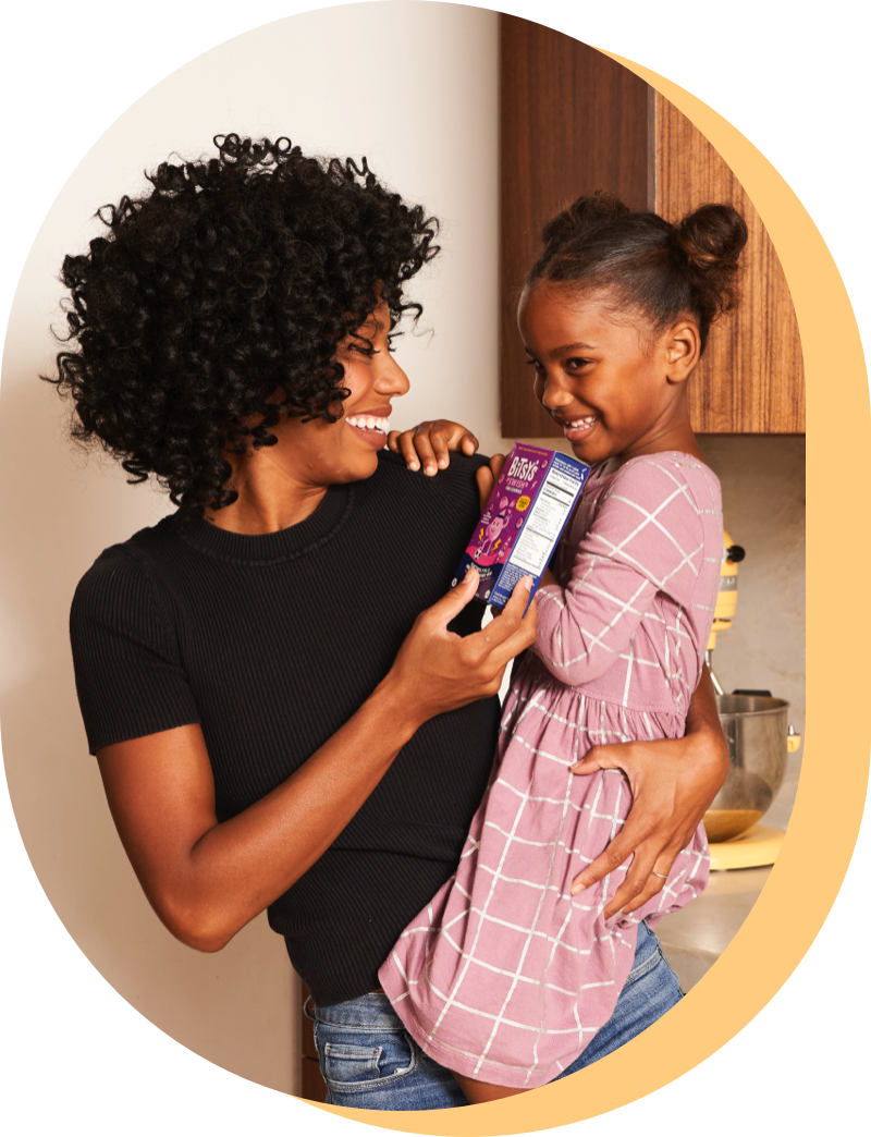 Image of woman and child hugging and holding a box of Bitsy's Swish.