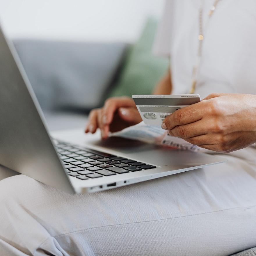 woman holding a debit card