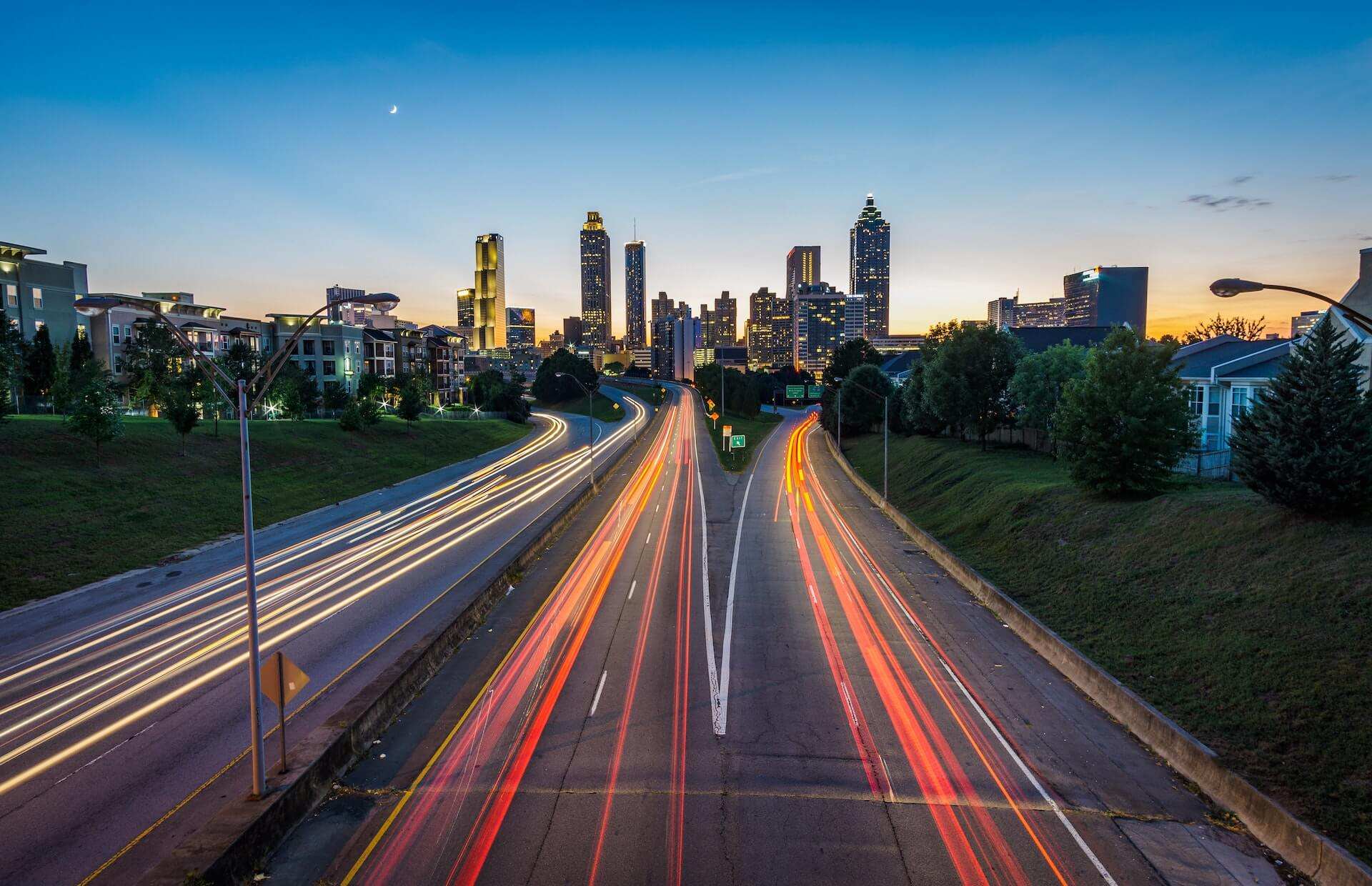 City with interstate, car lights stretched with overexposure