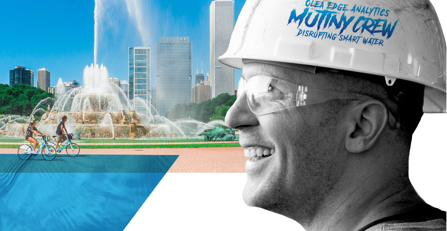 Man with hardhat smiling, city in background