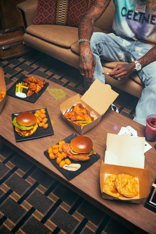 Wiz Khalifa eating HotBox by Wiz Khalifa food in the living room