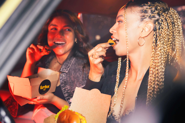 Women eating HotBox by Wiz Khalifa food