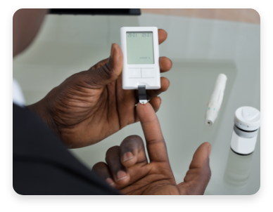 A person administers diabetes test on finger. Peripheral arterial disease (PAD) commonly affects people with diabetes and also people who smoke.