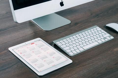 iPad with virtual calendar on a desk