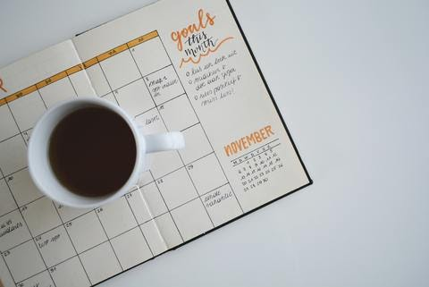 Cup of coffee on a planner