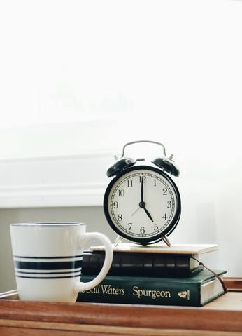 Alarm clock on top of  books