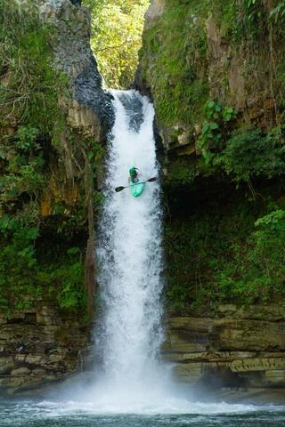 someone kayaking down a waterfall